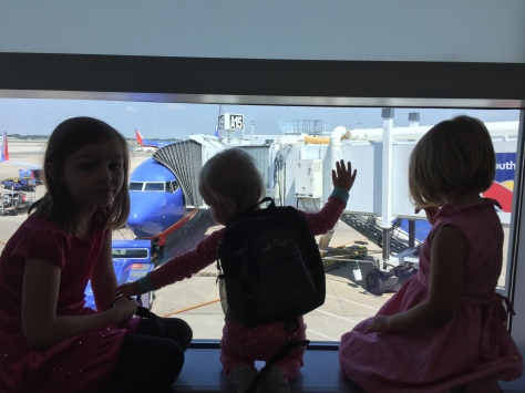 The girls checking out a jet at MDW.