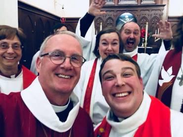 Pastor Kyle enjoys a moment with Bishop Michael Burk